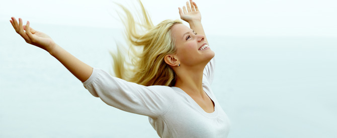 happy-woman-with-arms-outstretched1.jpg